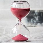 Hourglass demonstrates time passing which is expendable and valuable